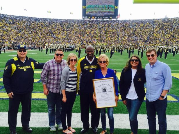 Michigan AD Jim Hackett, Michigan-Great Calvin O'Neal, and our Family at Halftime